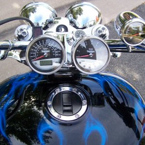 Instrument cluster with small skulls and cool blue paint
