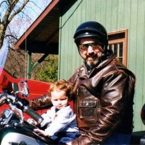 On my Harley with Grandson at 18 months, he's now 16
